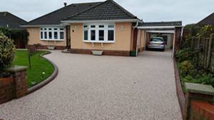 resin driveway with car port